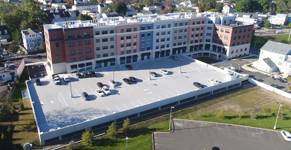 Park 215 parking deck mixed use building multi-family housing